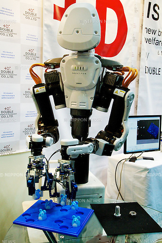 "The service robot ""Nextage"" performs at the Japan Robot Week 2014 on October 16, 2014 in Tokyo, Japan. Companies at the ""Japan Robot Week 2014"" exhibited their latest high-tech nursing and life supporting robots. The 2014 edition of the show ran from October 15 to 19 at Tokyo Big Sight. (Photo by Rodrigo Reyes Marin/AFLO)"
