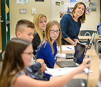 Teacher Michelle Ambrosini works with her seventh grade English Language Arts class Tuesday, November 07, 2017 at Holing Middle School in Buckingham, Pennsylvania. Ambrosini has been named Teacher of the Year by the Veterans of Foreign Wars Chapter 175 of Doylestown. (Photo by William Thomas Cain)