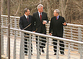 Shepherdstown, West Virginia - January 3, 2000 -- United States President Bill Clinton, center, walks across a 200 foot-long pedestrian bridge with Prime Minister Ehud Barak of Israel, left, and Foreign Minister Farouk al_Shara of Syria, right at the start of the Israeli-Syrian Peace Talks on 3 January, 2000..Credit: Ron Sachs  / CNP