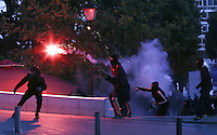 Pictured: A protester throws a flare Sunday 09 May 2016<br />Re: Riots break out between protesters and police in Syntagma Square, while MPs in the Greek Parliament vote for new tax, pension and welfare reforms in Athens, Greece