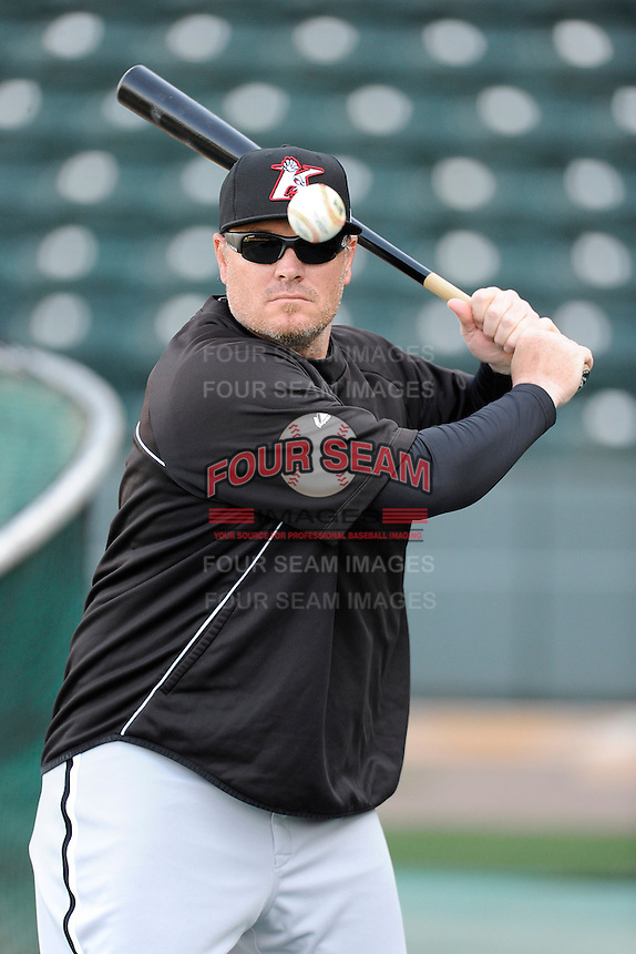 Manager Pete Rose Jr. (14) of the Kannapolis Intimidators hits ground balls during batting practice prior to a game against the Greenville Drive on Friday, April 11, 2014, at Fluor Field at the West End in Greenville, South Carolina. (Tom Priddy/Four Seam Images)
