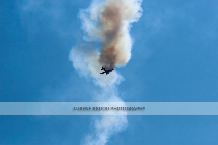 A plane doubles back through the smoke above Andrews Air Force Base during the 2008 Joint Service Open House air show.