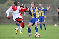 Sebastian Schoburgh of Beaconsfield challenges Paul Clayton of Romford - Romford vs Beaconsfield SYCOB - FA Cup Preliminary Round Football at Mill Field, Aveley FC - 29/08/10 - MANDATORY CREDIT: Gavin Ellis/TGSPHOTO - SELF-BILLING APPLIES WHERE APPROPRIATE. NO UNPAID USE. TEL: 0845 094 6026
