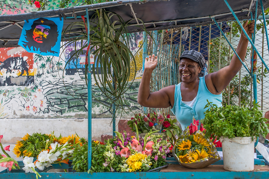 This image was taken in Cuba in 2013. I was exploring Havana's active streets when I came across this friendly local florist. Most of the Cuban people were extremely inviting and friendly but this woman especially. After we chatted, she presented me with a beautiful bouquet of her fresh flowers to take with me. I'll always remember her with fondness.