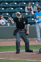 Home plate umpire Tyler Olson makes a strike call during the Carolina League game between the Myrtle Beach Pelicans and the Winston-Salem Dash at BB&T Ballpark on April 18, 2016 in Winston-Salem, North Carolina.  The Pelicans defeated the Dash 6-4.  (Brian Westerholt/Four Seam Images)
