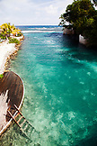 JAMAICA, Oracabessa. A deck leading to the water at the Goldeneye Hotel and Resort.
