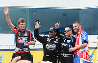 Apr. 15, 2012; Concord, NC, USA: NHRA top fuel dragster drivers (left to right) David Grubnic , Khalid Albalooshi , Brandon Bernstein and Dom Lagana during eliminations for the Four Wide Nationals at zMax Dragway. Mandatory Credit: Mark J. Rebilas-