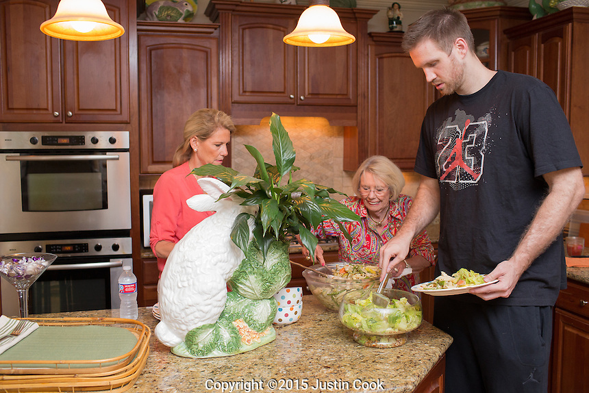 Shavlik Randolph at home with his mother Kim (left) and grandmother Beverley (Gigi) in  Raleigh, N.C. on Tuesday, June 23, 2015. (Justin Cook)