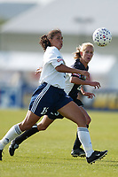 Shannon Boxx of the San Diego Spirit and Emily Stauffer of the New York Power chase down a ball during the May 25th game at Mitchel Athletic Complex. The Power won 2-1.