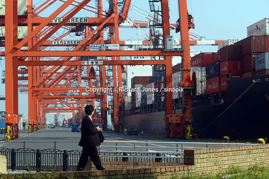 A businessman is walking by the port, Tokyo Bay, Japan