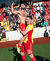 Albion Rovers' goal scorers Gary Fisher (no shirt) and John Gemmell (19) celebrate at the end of the game after winning the SPFL League Two.