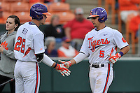 Center fielder Chase Pinder (5) of the Clemson University Tigers is congratulated after scoring a run by Seth Beer (28) in a game against the Wofford College Terriers on Tuesday, March 1, 2016, at Doug Kingsmore Stadium in Clemson, South Carolina. Clemson won, 7-0. (Tom Priddy/Four Seam Images)