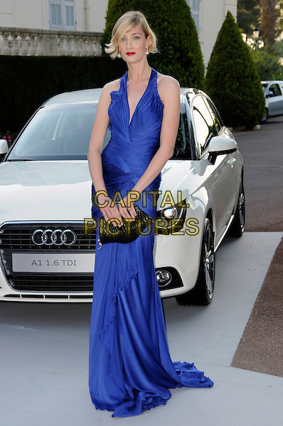 EVA RICCOBONO.arrivals at amfAR's Cinema Against AIDS 2010 benefit gala at the Hotel du Cap, Antibes, Cannes, France during the Cannes Film Festival.20th May 2010.amfar full length cobalt blue long maxi dress ruched halterneck black clutch bag .CAP/CAS.©Bob Cass/Capital Pictures.