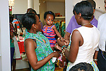 Nana Eyeson-Akiwowo holds her daughter during the African Health Now - Fashion Fete event, at the Tracy Reese store on 641 Hudson Street, June 20, 2013.