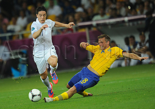 19.06.2012. Kiev, Ukraine. Sweden's Anders Svensson (R) and France's Yann Samir Nasri challenge for the ball during UEFA EURO 2012 group D soccer match Sweden vs France at NSC Olimpiyskiy Olympic stadium in Kiev, the Ukraine, 19 June 2012.