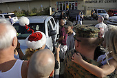 "Kailua, Hawaii - December 24, 2008 -- United States President-elect Barack Obama greets well wishers after working out at the gym at Marine Corps Base Hawaii at Kaneohe Bay in Kailua, Hawaii on Wednesday, December 24, 2008..Obama wished them ""Mele Kalikimaka"" which is Hawaiian for ""Merry Christmas""..Credit: Joaquin Siopack / Pool via CNP"