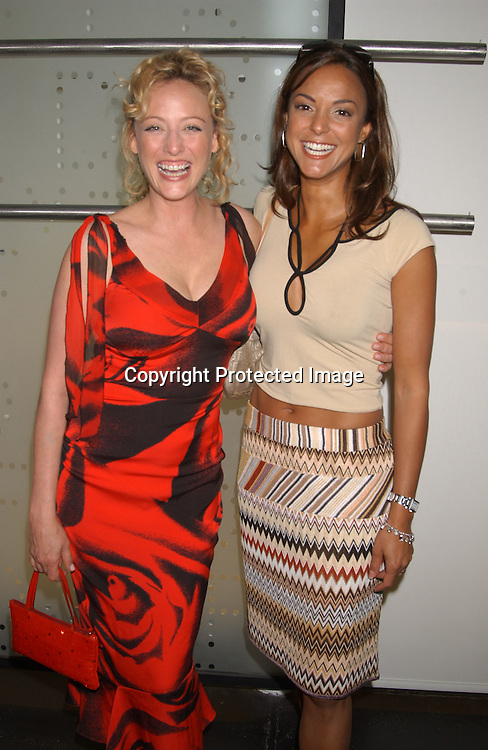 Virginia Madsen and Eva La Rue                                  ..at the Humane Society of the United States Save the Seal ..Party on July 23,2003 at Diane von Furstenberg's Studio in ..New York City, New York.                                              Photo by Robin Platzer, Twin Images