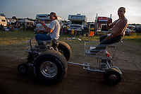 Aug. 17, 2013; Brainerd, MN, USA: NHRA fans drive a customized shopping cart in the Zoo campground outside of the pit area following qualifying for the Lucas Oil Nationals at Brainerd International Raceway. Mandatory Credit: Mark J. Rebilas-