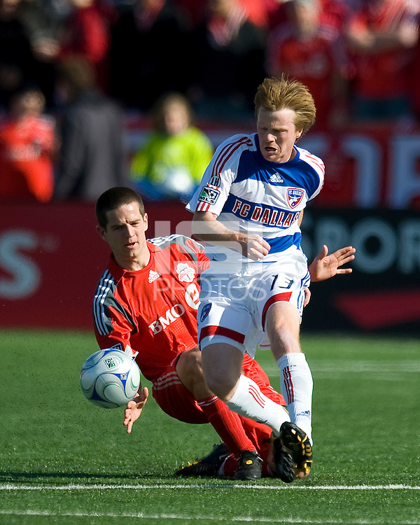11 April 2009: Toronto FC midfielder Sam Cronin #2 slide tackles FC Dallas midfielder Dax McCarty # 13 during an MLS game at BMO Field in Toronto between FC Dallas and Toronto FC. The game ended in a 1-1 draw.