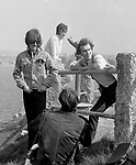 The Beatles 1967 George Harrison and John Lennon with Neil Aspinall film Magical Mystery Tour at Newquay, Cornwall ..© Chris Walter..