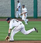 Reno Aces second basemen Taylor Harbin make the stop on a ground ball up the middle agianst the Colorado Sky Sox during their game on Wednesday night July 25, 2012 at Aces Ballpark in Reno NV.