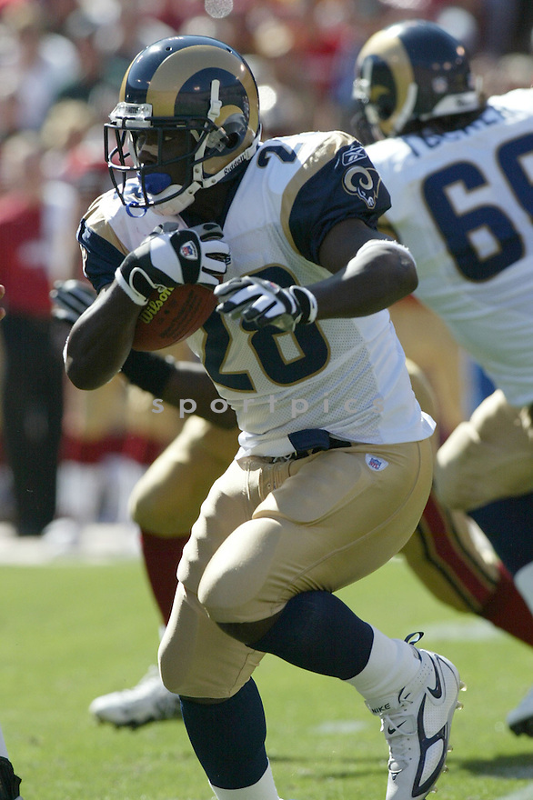 Marshall Faulk, of the St. Louis Rams, during thier game against the San Francisco 49ers on September 11, 2005...49ers win 28-25..Rob Holt / SportPics