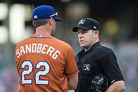 Home plate umpire Brian Peterson discusses a call with Durham Bulls manager Jared Sandberg (22) during the game against the Charlotte Knights at BB&T BallPark on May 16, 2017 in Charlotte, North Carolina.  The Knights defeated the Bulls 5-3. (Brian Westerholt/Four Seam Images)