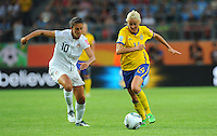 Carli Lloyd of team USA and Josefine Oqvist of team Sweden during the FIFA Women's World Cup at the FIFA Stadium in Wolfsburg, Germany on July 6thd, 2011.
