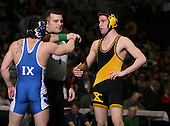 Shawn Brown (X) and Jamie Franco (IX) square off in the NY State Division One finals at the 125 weight class during the NY State Wrestling Championship finals at Blue Cross Arena on March 9, 2009 in Rochester, New York.  (Copyright Mike Janes Photography)