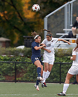 Yale University forward Paula Hagopian (14) and Harvard University midfielder Kate Makaroff (18) battle for head ball. In overtime, Harvard University defeated Yale University,1-0, at Soldiers Field Soccer Stadium, on September 29, 2012.