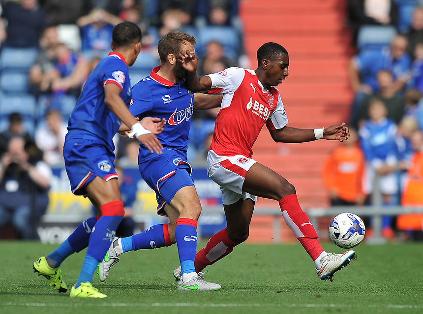 Fleetwood Town's Amari'i Bell is tackled by Oldham Athletic's Liam Kelly<br /> <br /> Photographer Dave Howarth/CameraSport<br /> <br /> Football - The Football League Sky Bet League One - Oldham Athletic v Fleetwood Town - Saturday 15th August 2015 - SportsDirect.com Park - Oldham<br /> <br /> &copy; CameraSport - 43 Linden Ave. Countesthorpe. Leicester. England. LE8 5PG - Tel: +44 (0) 116 277 4147 - admin@camerasport.com - www.camerasport.com