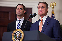 "United States Senator David Perdue (Republican of Georgia), right, makes an announcement on the introduction of the Reforming American Immigration for a Strong Economy (RAISE) Act in the Roosevelt Room at the White House in Washington, D.C., U.S., on Wednesday, August 2, 2017. The act aims to overhaul U.S. immigration by moving towards a ""merit-based"" system. Pictured at left is US Senator Tom Cotton (Republican of Arkansas). Photo Credit: Zach Gibson/CNP/AdMedia"