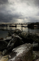 Wooden Jetty stretching over the water close to. Deep Cove, Burard Inlet, North Vancouver, British Columbia, Canada.