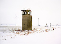Wind turbines can be seen behind a deserted watchtower from the Cold War.. CHECK with MRM/FNA