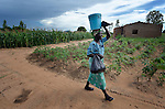 Willis Banda carries water home in Dofu, an area in northern Malawi which has been hit hard by drought and hunger.