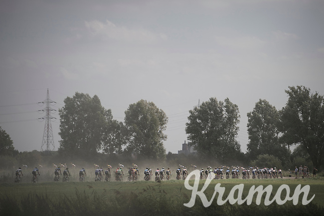 stretched peloton over one of the many gravel sections<br /> <br /> 91th Schaal Sels 2016