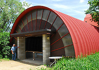 Gary Zimmer poses with an early Wisconsin Quonset hut, home to scores of young chickens, at Otter Creek Organic Farms on Sunday, 6/14/09, near Taliesin and Spring Green, Wisconsin