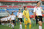 09 August 2008: Captain Birgit Prinz (GER) (9) and goalkeeper Nadine Angerer (GER) (1) lead the Germany team onto the field, pregame.  The women's Olympic soccer team of Germany defeated the women's Olympic soccer team of Nigeria 1-0 at Shenyang Olympic Sports Center Wulihe Stadium in Shenyang, China in a Group F round-robin match in the Women's Olympic Football competition.