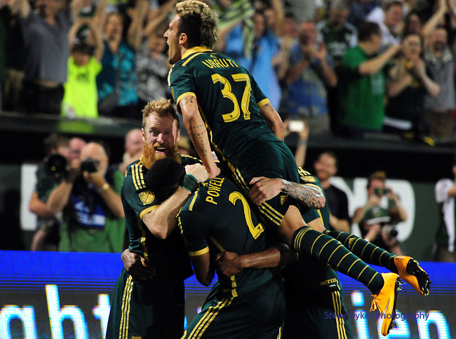 Jun 6, 2015; Portland, OR, USA; Portland Timbers Portland Timbers defender Nat Borchers (7), defender Alvas Powell (2) and midfielder Maximiliano Urruti (37) celebrate with Portland Timbers forward Fanendo Adi (9) after he scored a goal during the second half of the game against the New England Revolution at Providence Park. The Timbers won the game 2-0. Mandatory Credit: Steve Dykes-USA TODAY SportsJun 6, 2015; Portland, OR, USA; during the second half of the game at Providence Park. The Timbers won the game 2-0. Mandatory Credit: Steve Dykes-USA TODAY Sports