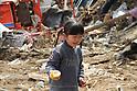 "March 29, 2011, Minamisanriku, Miyagi, Japan - More than two weeks after the tsunami the rural area between Kesennuma and Minamisanriku lies in ruin. ""I found a can of our food."" Says Saya Okoshi (6). (Photo by Wesley Cheek/AFLO) [3682]."
