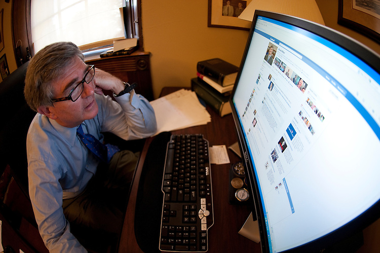 UNITED STATES - JULY 21: Rep. Brad Miller, D-N.C., checks his Facebook page in his office in the Longworth House Office Building on  July 21, 2011. (Photo By Bill Clark/Roll Call)