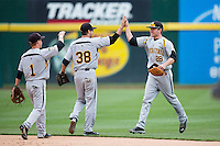 Garrett Bayliff #28 of the Wichita State Shockers high fives Erik Harbutz #38 of the Wichita State Shockers and Tanner Dearman #1 of the Wichita State Shockers after beating the Missouri State Bears at Hammons Field on May 5, 2013 in Springfield, Missouri. (David Welker/Four Seam Images)