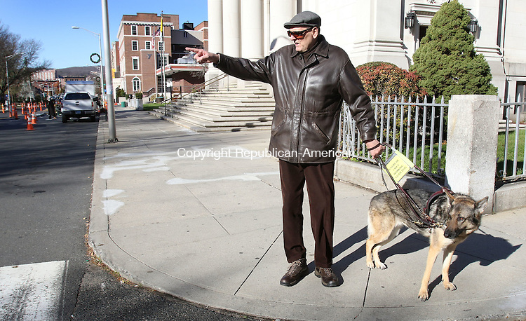 WATERBURY CT. 23 November 2015-112315SV06-Ross Kirk of Waterbury, who is blind, with his dog Zeva, tries to cross the street in a clearly marked crosswalk on West Main Street in Waterbury Monday.<br /> Steven Valenti Republican-American
