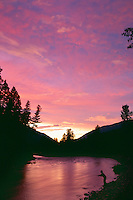 Fly fishing on Rock Creek at sunset<br /> Rock Creek Canyon<br /> Lolo National Forest<br /> Rocky Mountains,  Montana