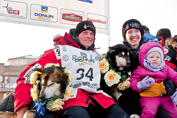 Dallas Seavey with lead dogs and family after he arrives in Nome to win his first Iditarod. At age 25, he is the youngest person ever to win an Iditarod. Iditarod 2012, Alaska. His father Mitch won the race in 2004, and his grandfather Dan is also running this race (3 generations of Seaveys on this race)