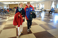 CROYDON PA - DECEMBER 27:  Lynne Plunkett (L) and Joe Hunter of Croydon, Pennsylvania carry winter coats they received at a Christmas luncheon and coat give away for people in need December 27, 2014 at Father Crehan Hall in Croydon, Pennsylvania. (Photo by William Thomas Cain/Cain Images)
