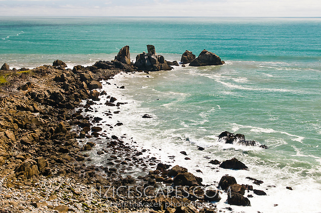 Rugged coastline with rock formations at Cape Foulwind near Westport, West Coast, New Zealand