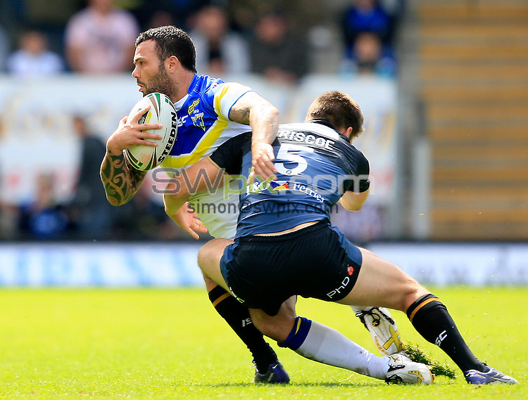 PICTURE BY CHRIS MANGNALL /SWPIX.COM...Rugby League - Super League  - Warrington Wolves v Hull FC - Halliwell Jones Stadium, Warrington, England  - 24/06/12... Warrington's Chris Bridge  tackled by Hull's Tom Briscoe