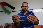 "Palestinian artist Magdy Abu Takeya, 38, converts gunshots used by the Israeli security forces against Palestinian protesters to small pieces of art knows as ""Art of thumbnails"" at his house in Nuseirat in the central Gaza Strip, on April 25, 2018. Photo by Ashraf Amra"