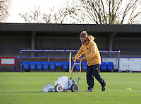 The ground staff prepare the pitch for the Sky Bet League 2 match between AFC Wimbledon and Wycombe Wanderers at the Cherry Red Records Stadium, Kingston, England on 21 November 2015. Photo by Alan  Stanford/PRiME.